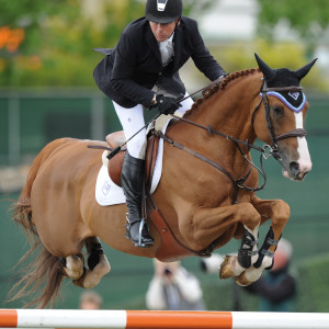 "2008 Olympic Champion Eric Lamaze riding Wang Chung M2S scored victory in the $40,000 ATCO Structures & Logistics Cup on Sunday, June 9, at the Spruce Meadows ""National"" Tournament in Calgary, AB. Photo by Spruce Meadows Media Services"