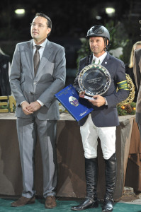 Eric Bruger (left), publisher of L'Annee Hippique, presents Eric Lamaze with the 2011 'Rider of the Year' Award at CSI5*-W Geneva, Switzerland. Photo by Kit Houghton