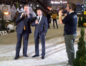 2008 Olympic Champion Eric Lamaze (right) gives a course description to the audience with Alban Poudret at CSI5*-W Geneva, Switzerland. Photo by Revolution Sports
