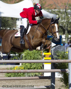 Eric Lamaze riding Coriana van Klapscheut is currently ranked 11th individually while the Canadian Show Jumping Team is fifth following the opening day of competition at the XVI Pan American Games in Guadalajara, Mexico. Photo by Cealy Tetley