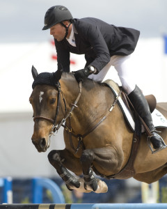 Olympic Champion Eric Lamaze in action wearing the 'Digital' glove from sponsor SSG Gloves. Photo by Cealy Tetley